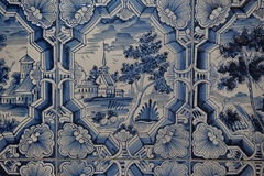 Blue white paintings on a tiled stove Royalty Free Stock Image