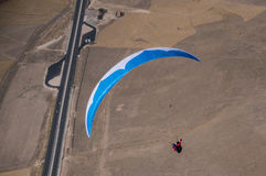 Blue and white paraglider Royalty Free Stock Images