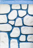 Blue and white pebbled wall Stock Images