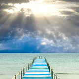 Blue and white pier stock image