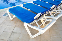 Blue and white plastic lounges Royalty Free Stock Images