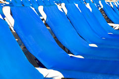Blue and white plastic lounges Stock Photos