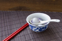 Blue and white porcelain bowls filled with dumplings Stock Photography