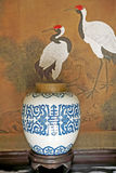 Blue and white porcelain jar. Traditional blue and white porcelain jar on Chinese ancient painting background Royalty Free Stock Photography