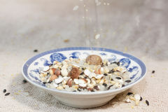 The blue and white porcelain plate with  all kinds of grain Stock Photography