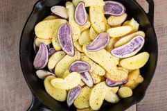 Blue and white potatoes frying Stock Photo