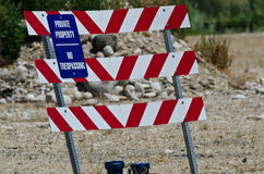 Blue and White Private Property Sign on Construction Barricade Stock Photo