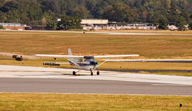 Blue and White Prop Plane on Runway Stock Photo