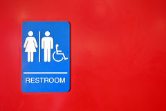 Blue and White Public Washroom Sign. A close up image of a blue and white public washroom sign on a bright red door Royalty Free Stock Photos