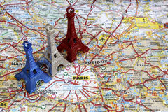 Blue white and red Eiffel tower on Paris map. Blue white red color Eiffel tower key chain on Paris Map Royalty Free Stock Photos