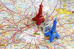 Blue white and red Eiffel tower on Paris map. Blue white and red color Eiffel tower key chain on Paris Map stock images