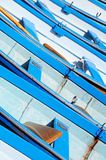 Blue and white rowing boats. Stock Image