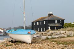Boat with `The Black House` at Mudeford, Dorset, UK royalty free stock photography