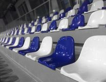 Blue and white seats at the tribune. Empty blue and white seats at the tribune, stadium Royalty Free Stock Photography