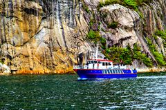The blue and white ship, cliffs and sea Stock Photos