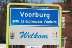 Blue white sign as start of the urban area of Voorburg as part of municipality Leidschendam-Voorburg in the Netherlands. Blue white sign as start of the urban royalty free stock images