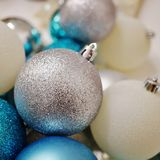 Blue, white and silver glittery Christmas holiday ornaments Royalty Free Stock Photos