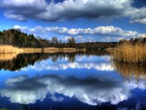 Blue and white sky. Area with a lot of fish ponds in Bavaria/Germany stock photo