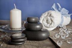 Blue white spa set. Massage stones, candle, towel. Royalty Free Stock Photo