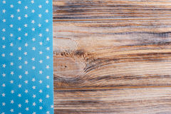 Blue white star tablecloth on wooden table Stock Photo