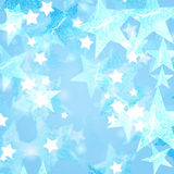 Blue and white stars. Over bluish background with feather center Stock Images