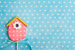 Blue white stars background with pink bird house. ю Baby shower party invitation, top view Royalty Free Stock Photography