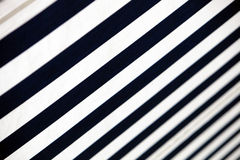 Blue-white- striped awning - close-up Royalty Free Stock Photography
