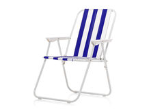 Blue and white striped beach chair. Isolated on white background Stock Image