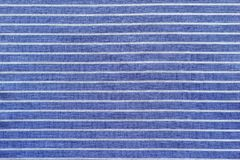 Blue white striped cotton with grained texture Stock Images