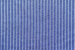 Blue white striped cotton with grained texture Royalty Free Stock Images