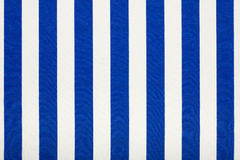Blue and white striped fabric, texture background. Blue and white striped fabric background Stock Image
