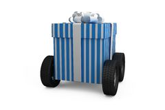 Blue and white striped gift box on wheels Royalty Free Stock Image