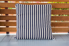Blue and white striped pillow on terrece Royalty Free Stock Photo
