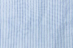 Blue and white striped seamless fabric. stock photo
