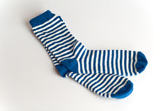 Blue and white striped socks on white background Stock Photo