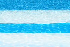 Blue and white striped swimming pool background Stock Images