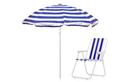 Blue and white striped umbrella and beach chair stock image