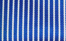 Blue and white stripes fabric closeup Stock Images