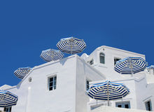 Blue white sunshade umbrellas Stock Images
