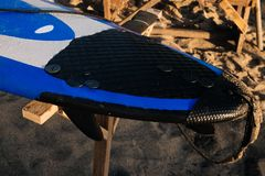 Blue and white surfboard lying on a board rack ready for surfing. close up.Bali.Indonesia. Surf boards on sandy beach royalty free stock images