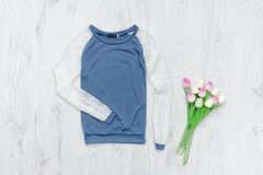 Blue and white sweater, bouquet of tulips. Fashionable concept.  Royalty Free Stock Photography