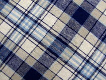 Blue and White Tartan Fabric. Macro photograph of tartan fabric, suitable for backgrounds Royalty Free Stock Photos