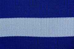 Blue-white texture made from cloth with stripes. Colored background of a piece of cloth with stripes Royalty Free Stock Photo