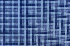 Blue white texture of a piece of cloth with a pattern. Blue white background of a piece of cloth with a pattern Stock Image