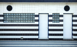 Blue and white tiled facade with glass blocks Stock Photo