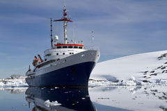 Blue with white tourist ship summer day in Antarctic Royalty Free Stock Photos