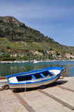 Blue and white traditional boat. Sicily, Italy Royalty Free Stock Photos