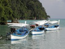 Blue and White Traditional Thai Longtail Boats stock images