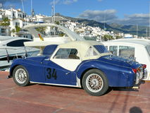 Blue and white Triumpfh TR3 in Puerto Banus Stock Image