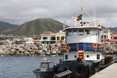 Blue and White Tugboat at Dock in St Kitts Royalty Free Stock Image